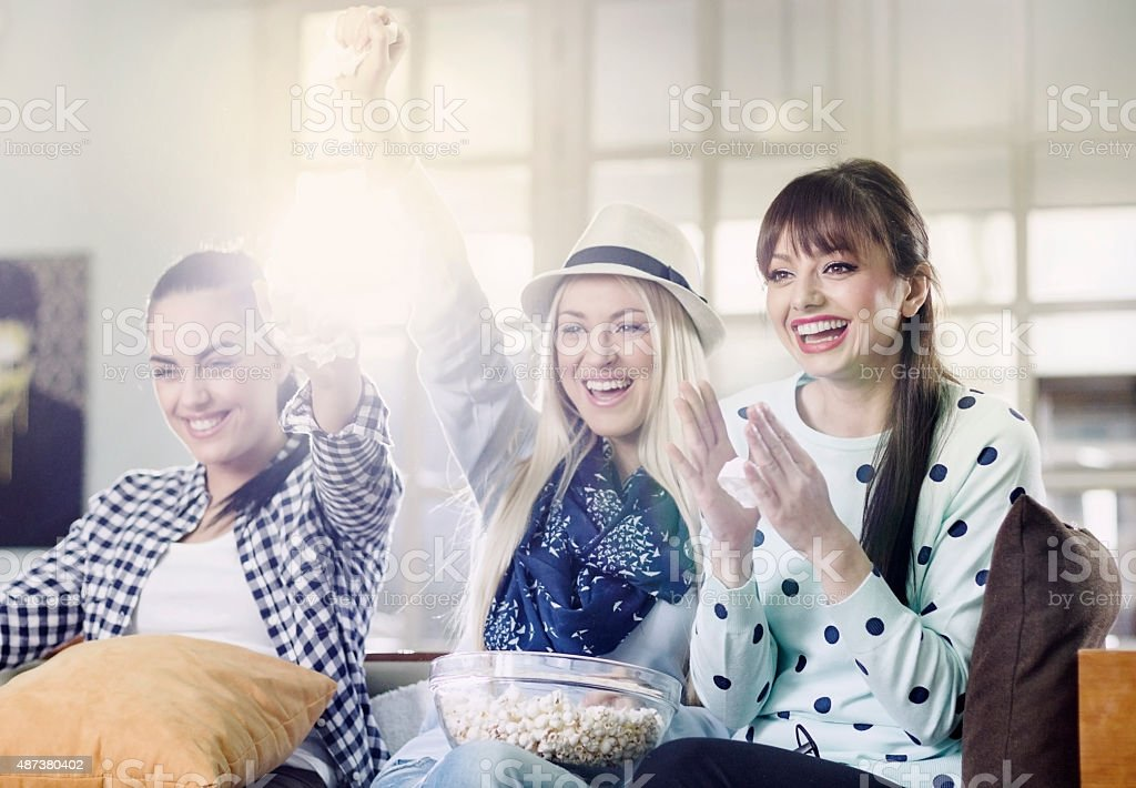 Group Of Women Fans Watching TV stock photo