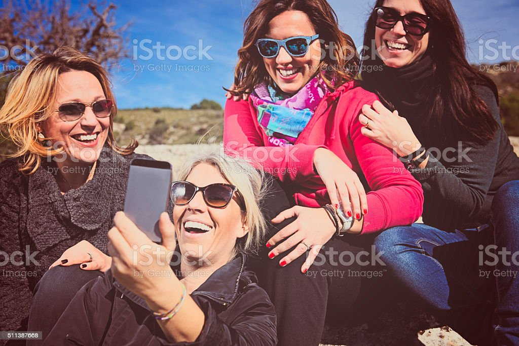Group of Women Friends Doing a Selfie stock photo