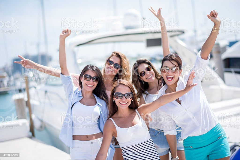 Group of women going on holidays  on a yacht stock photo
