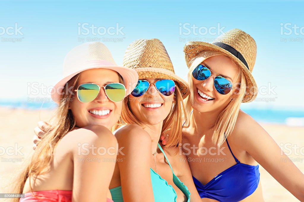 Group of women having fun on the beach stock photo