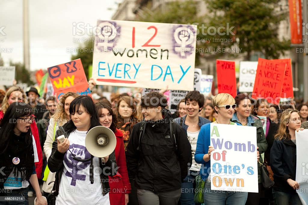Group of women holding informational posters regarding abortion stock photo
