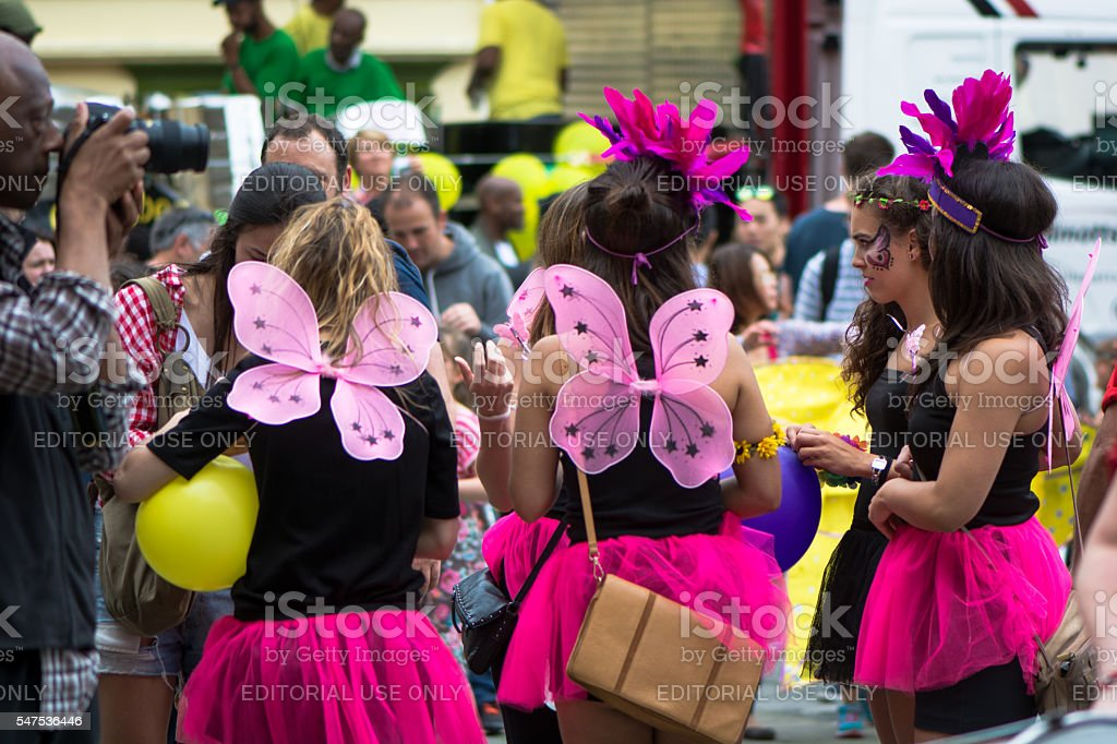 Group of women in pink short skirts being photographed stock photo