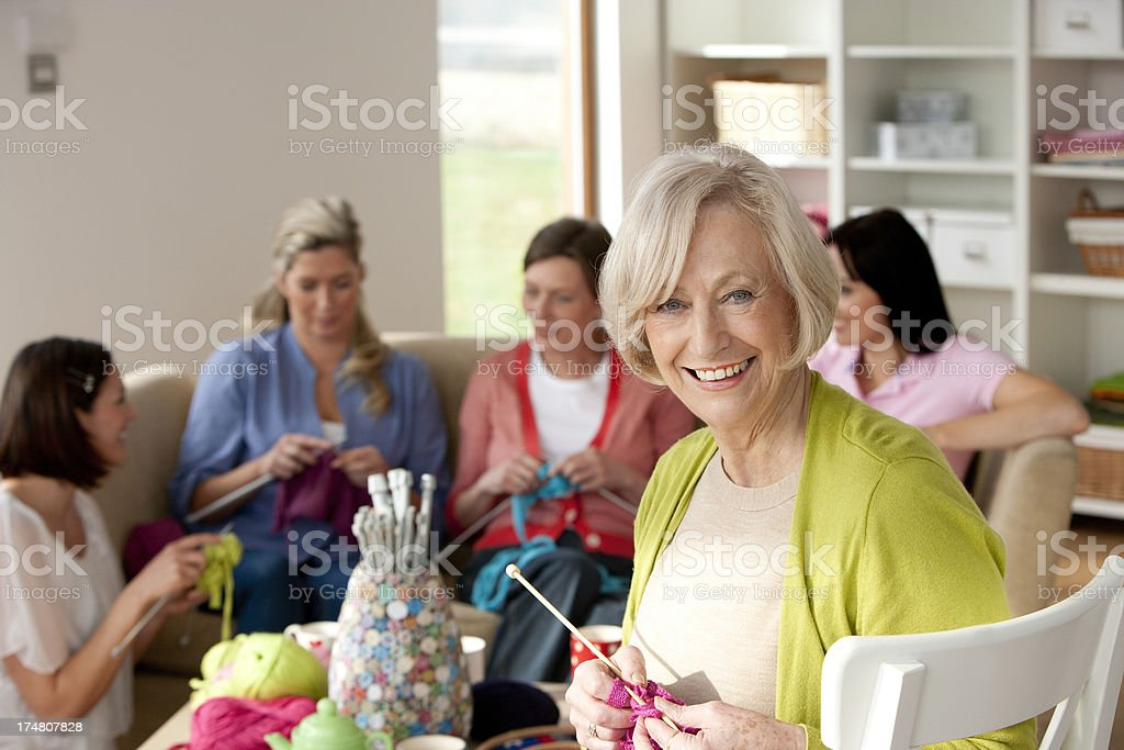 Group Of Women Knitting stock photo