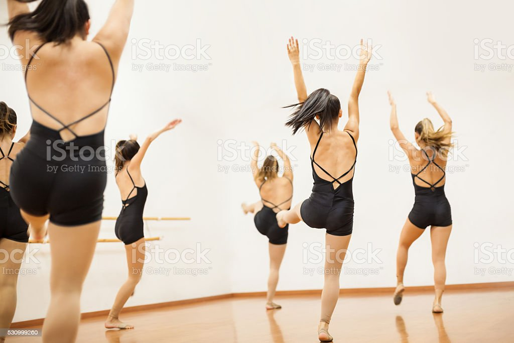 Group of women practicing a dance routing stock photo
