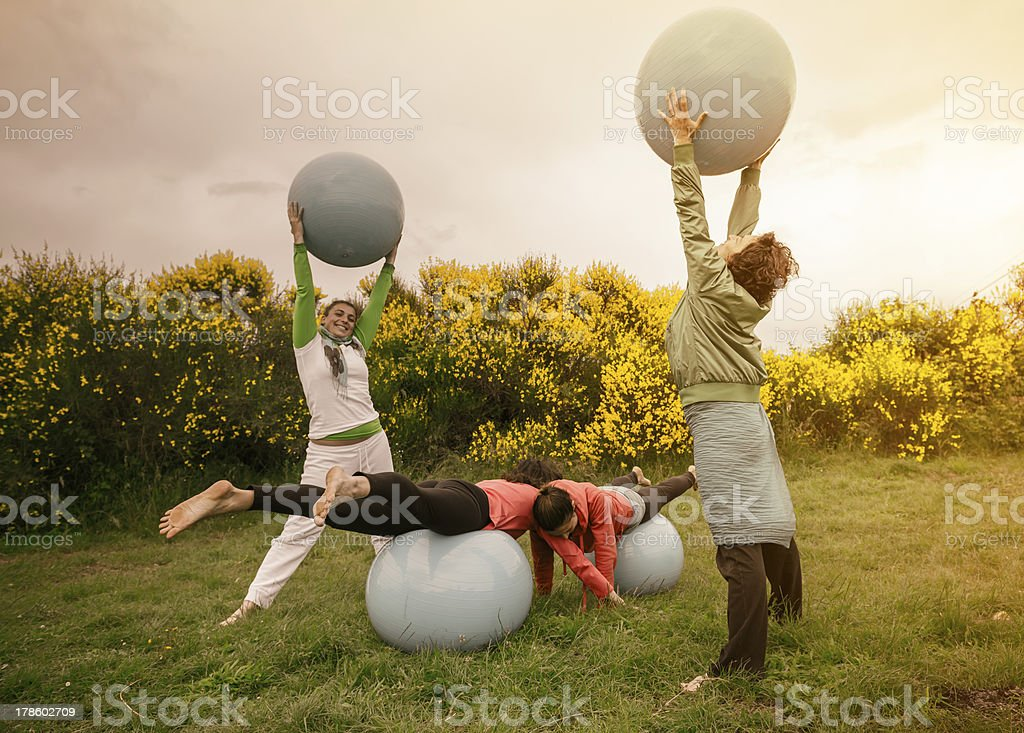 Group of women practicing yoga royalty-free stock photo