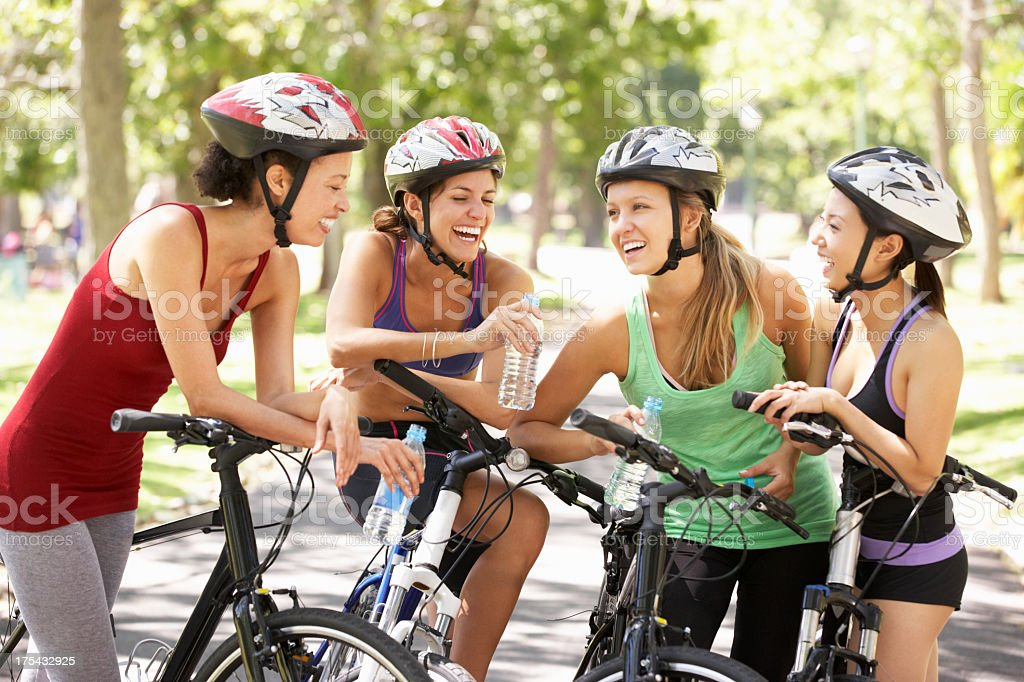 Group Of Women Resting During Cycle Ride Through Park royalty-free stock photo