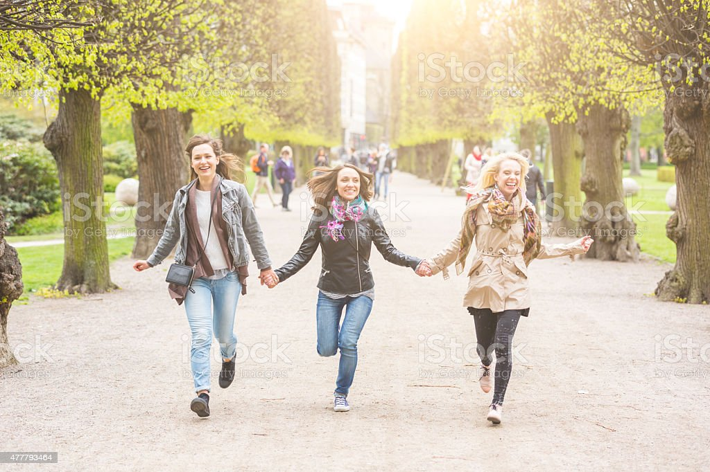 Group of women running at park stock photo