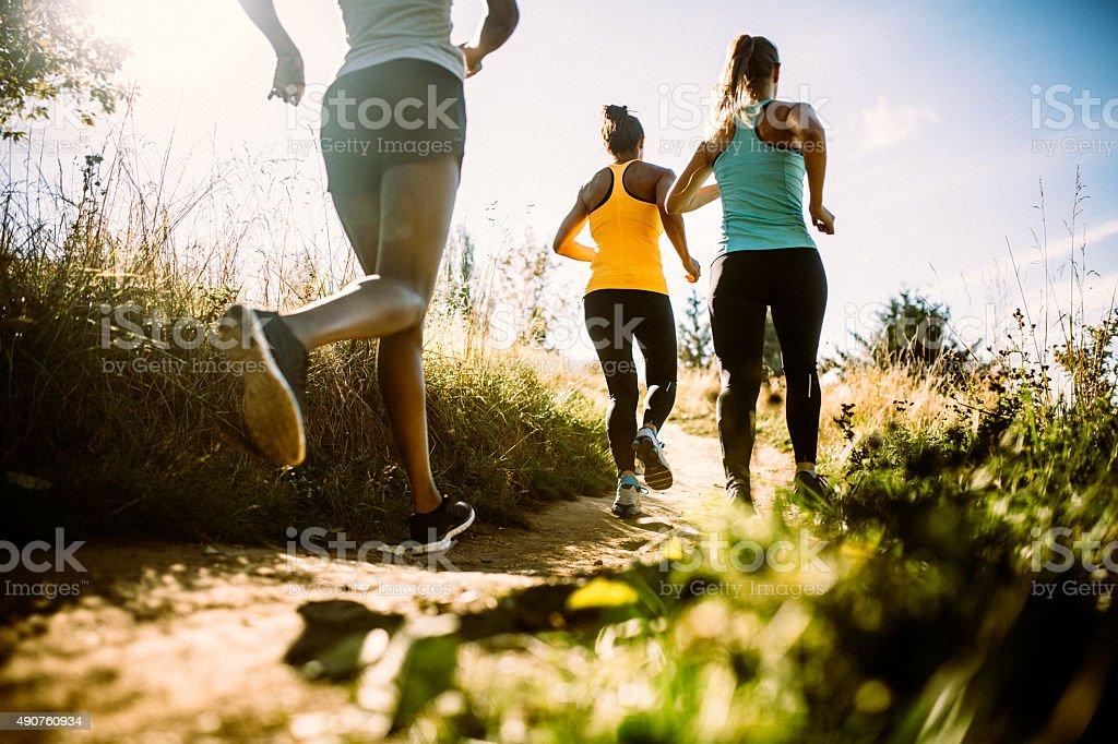 Group of Women Running Dirt Trail stock photo