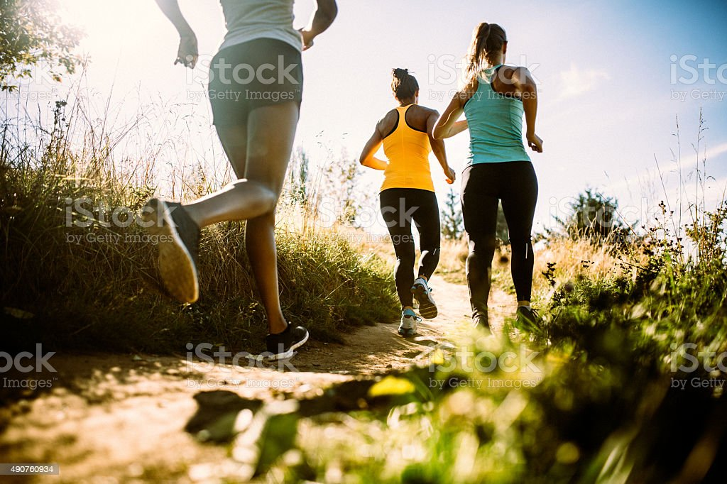 Group of Women Running Dirt Trail stock photo