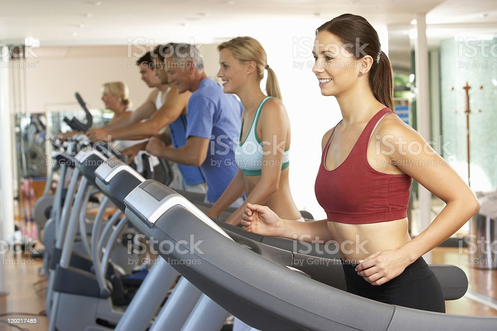 Group of women running on treadmills in the gym royalty-free stock photo