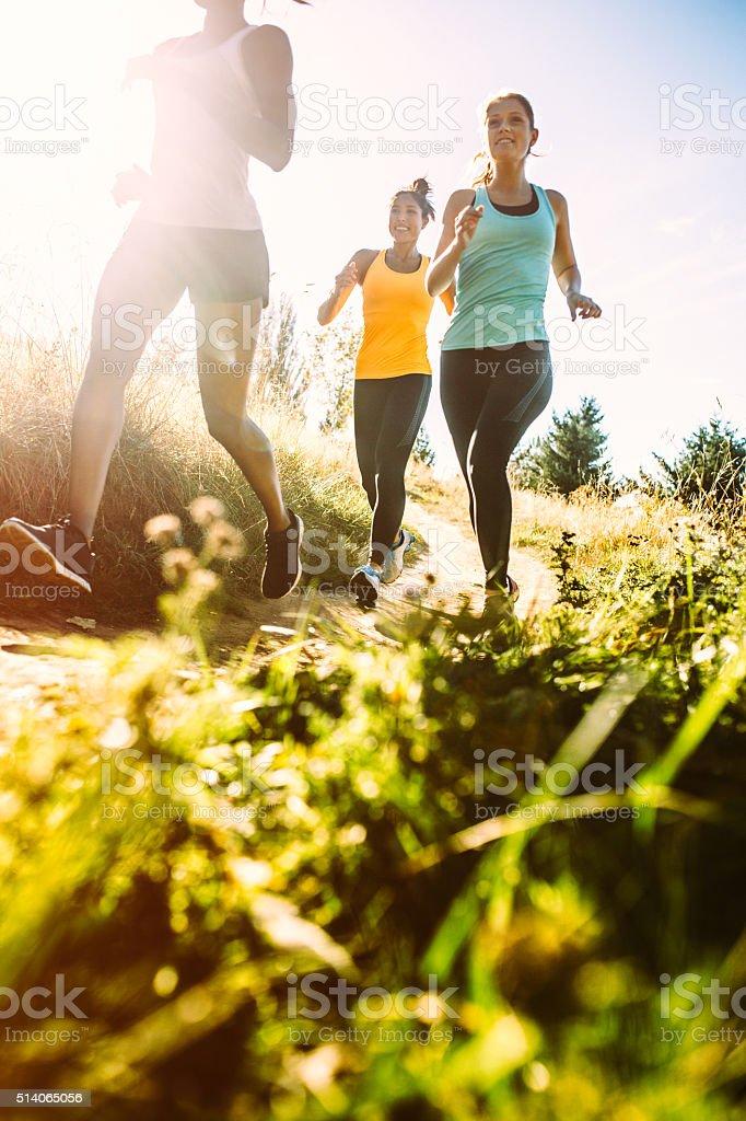 Group of Women Running Outdoors stock photo