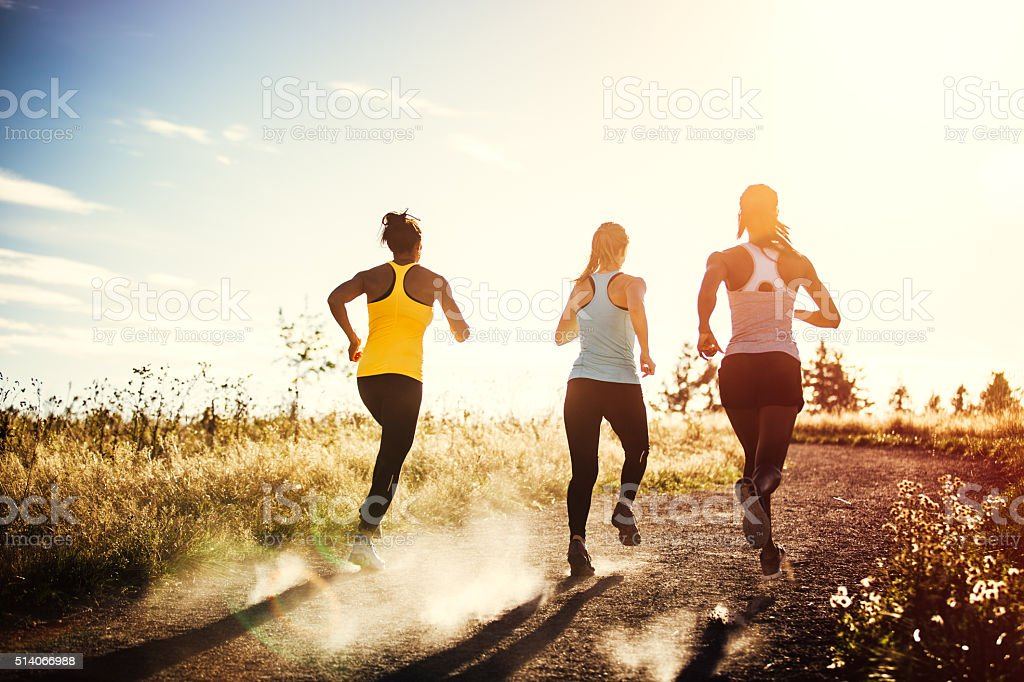 Group of Women Running Outdoors stock photo