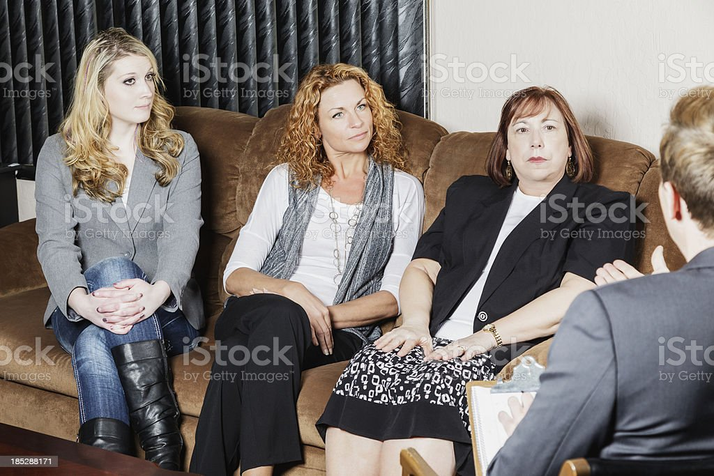 Group of Women Speak to Counselor stock photo