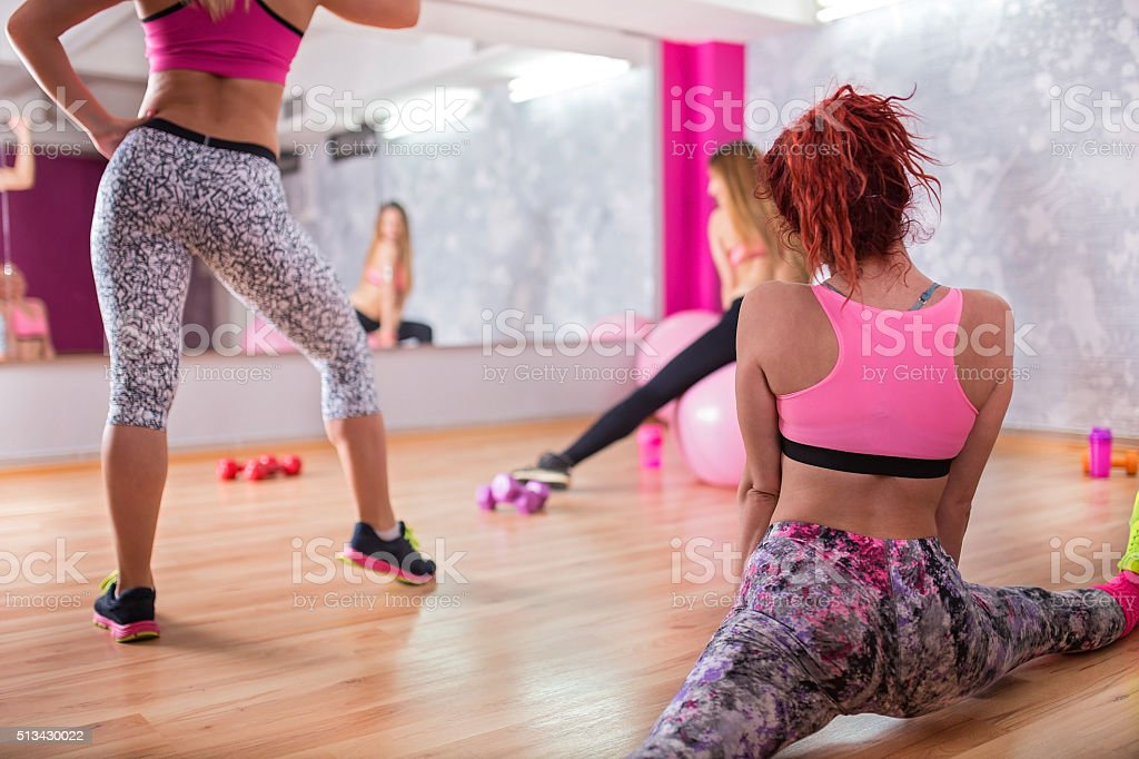 Group of women stretching out stock photo