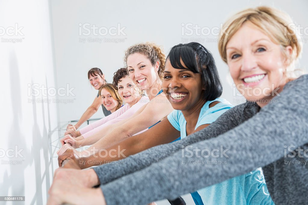 Group of women taking an exercise class stock photo
