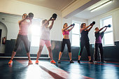 Group of Women Training with Kettle Bells