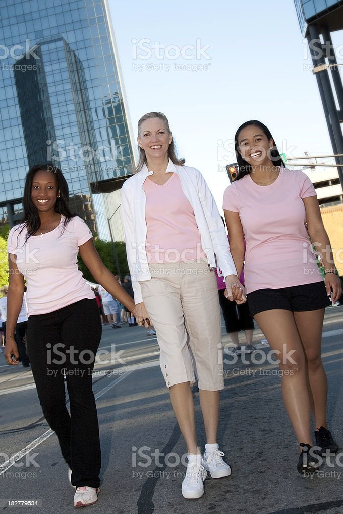 Group of Women Walking Together in a Cancer Awareness Walk royalty-free stock photo