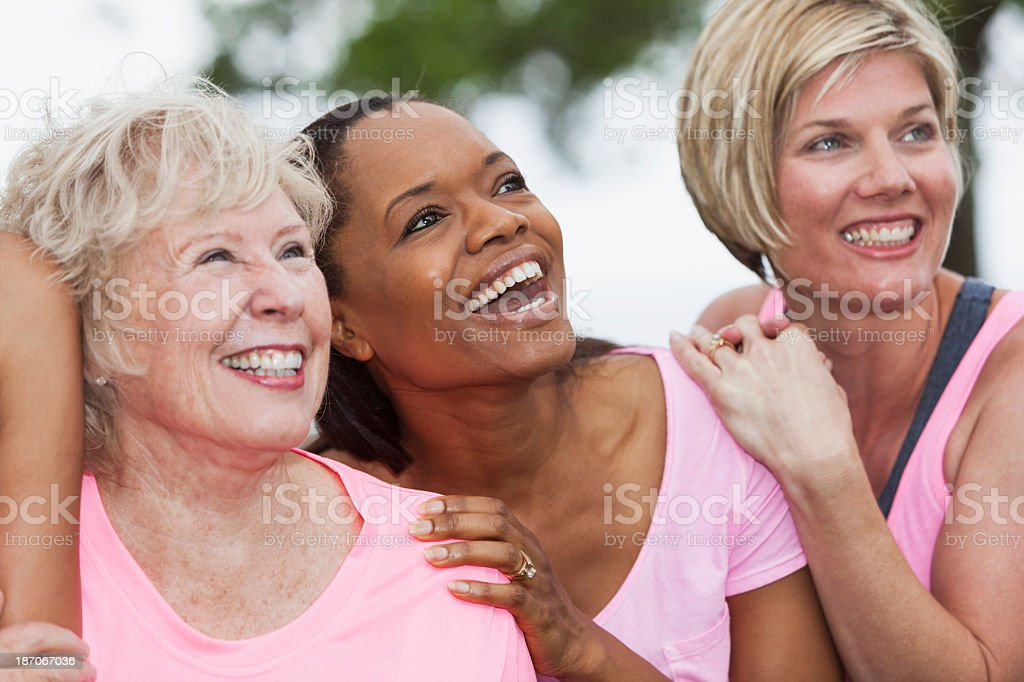 Group of women wearing pink stock photo