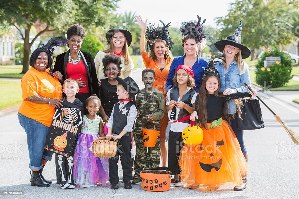 Group of women with children in halloween costumes stock photo