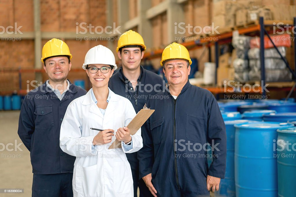 Group of workers at a chemical factory stock photo
