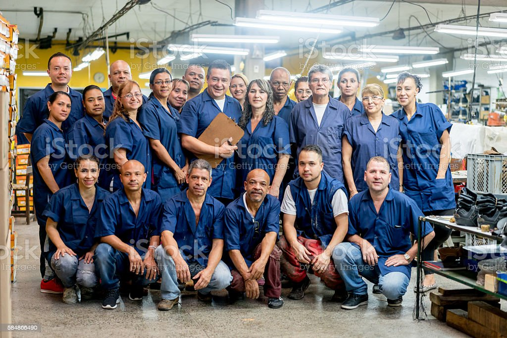 Group of workers at a factory stock photo