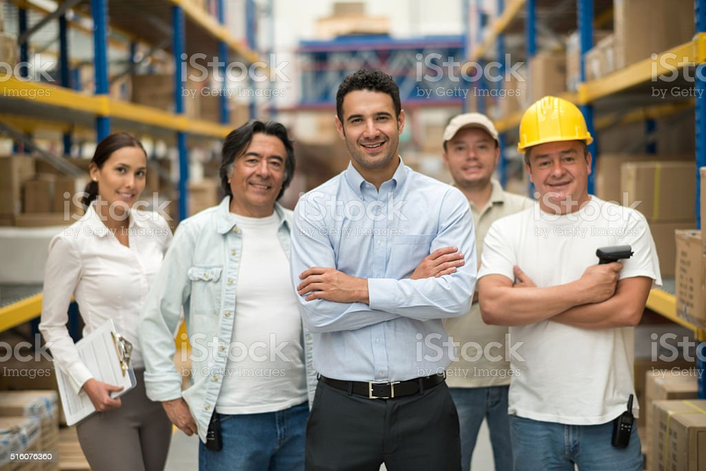 Group of workers at a warehouse stock photo