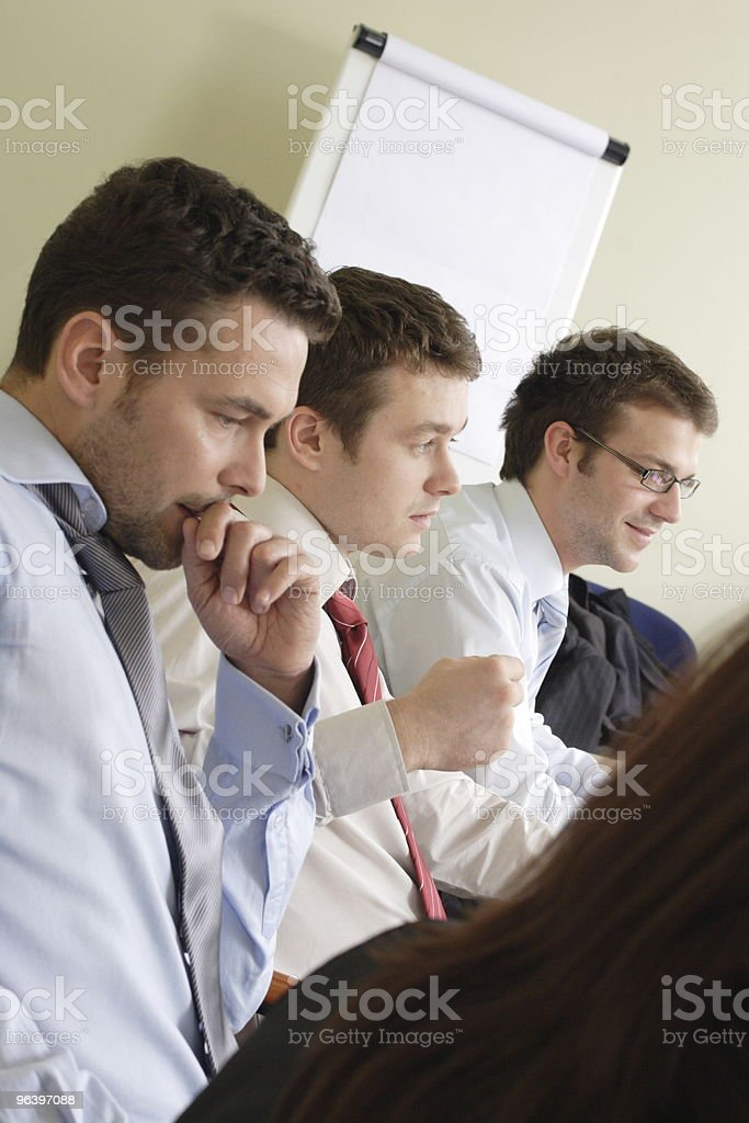 A group of workers in a boardroom royalty-free stock photo