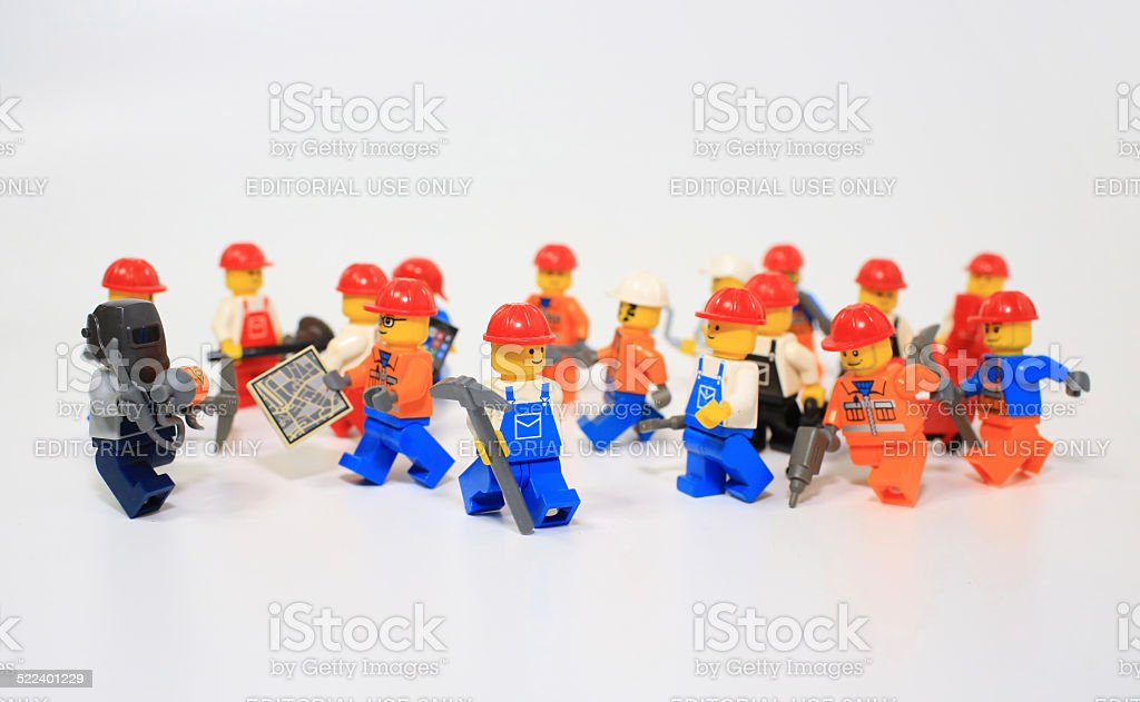 Group of workers lego mini figure stock photo
