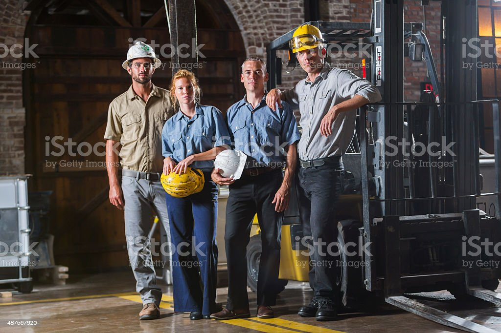 Group of workers with hardhats standing together stock photo