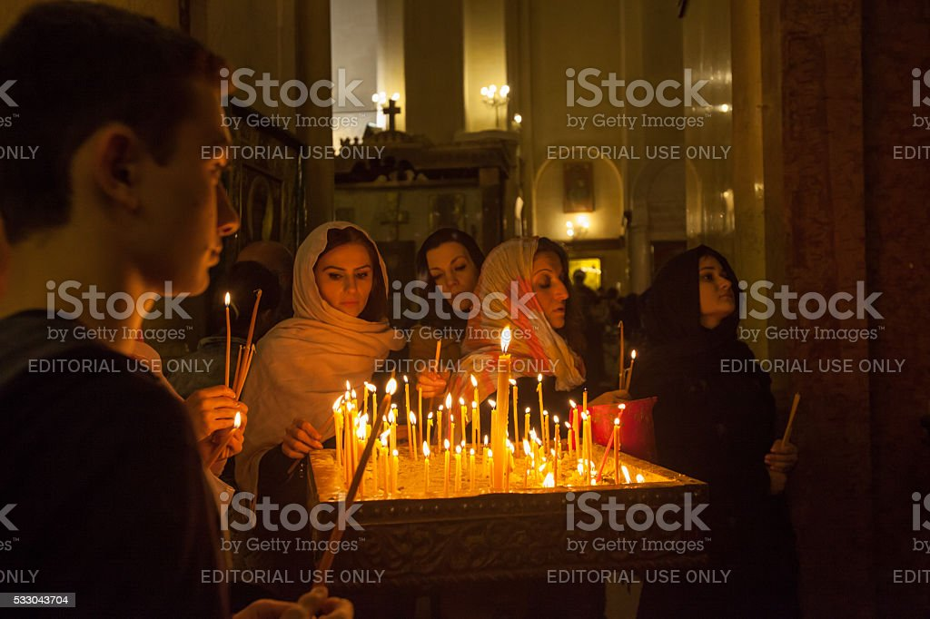 Group of worshipers at Holy Trinity Cathedral of Tbilisi stock photo