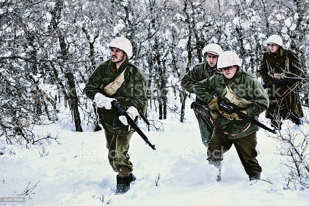 Group of WWII Winter Soldiers Walking stock photo