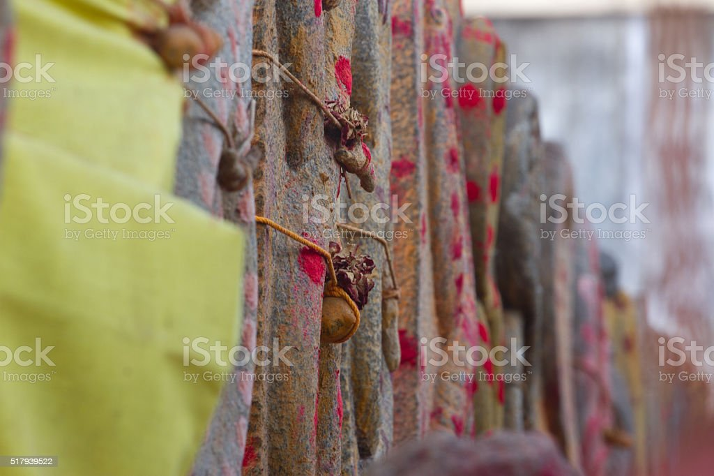 Group of yellow monuments with red dots in Shiva temple stock photo