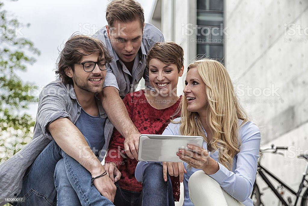 group of young adult with tablet pc stock photo