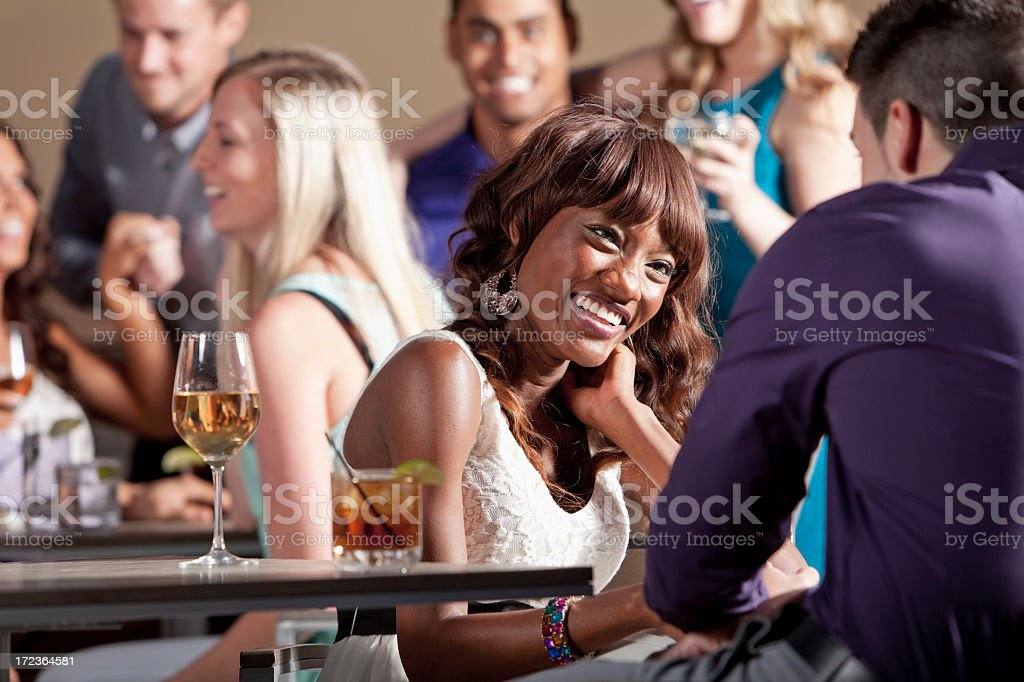 Group of young adults at party stock photo