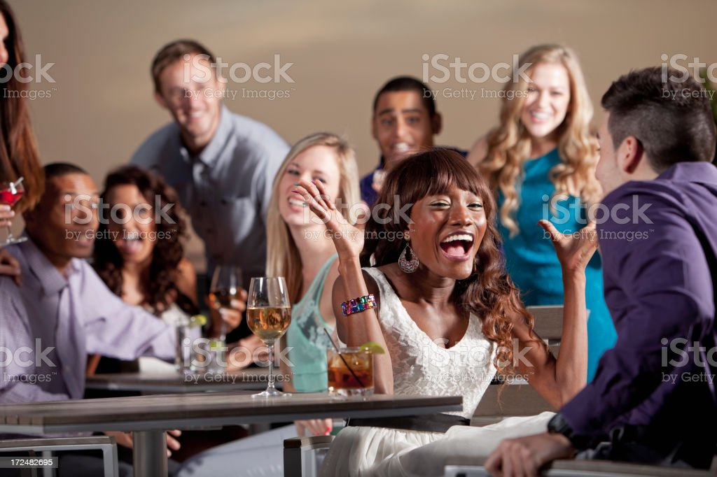 Group of young adults at party royalty-free stock photo