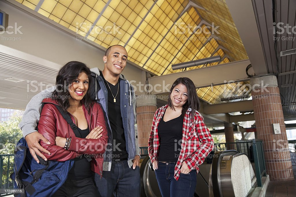 Group of young adults at train station stock photo