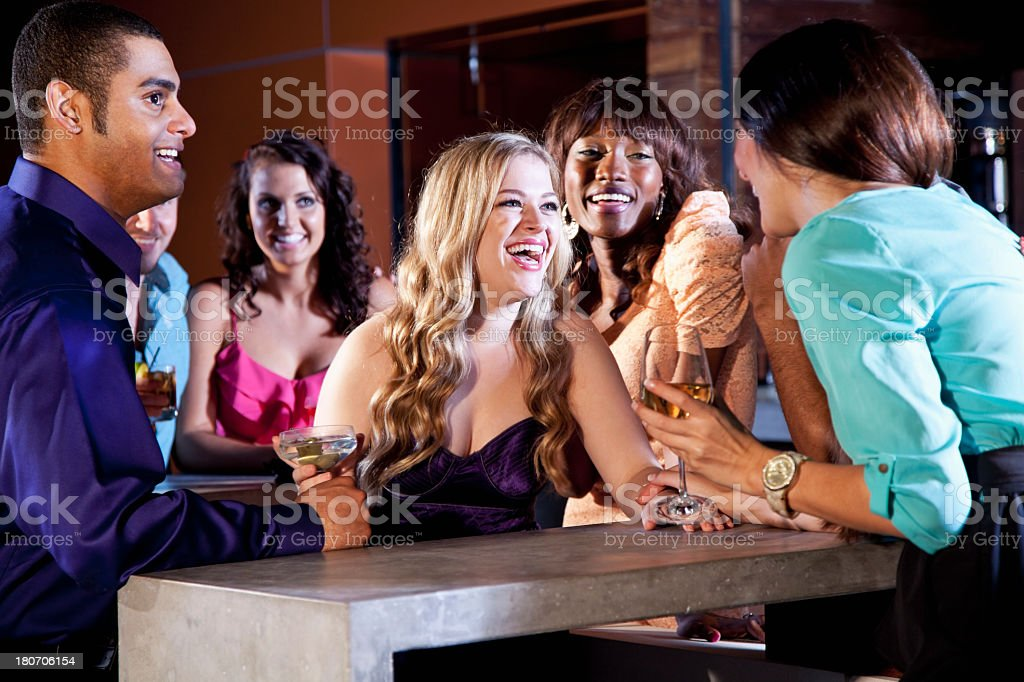 Group of young adults drinking outdoors royalty-free stock photo