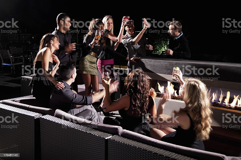 Group of young adults drinking royalty-free stock photo