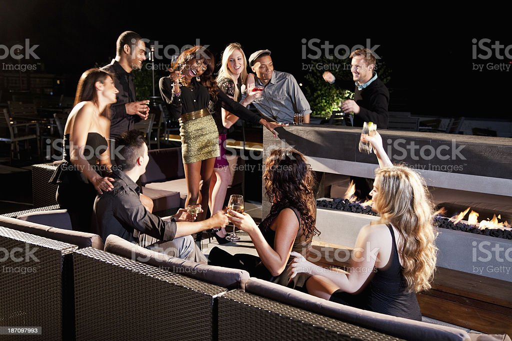 Group of young adults drinking stock photo