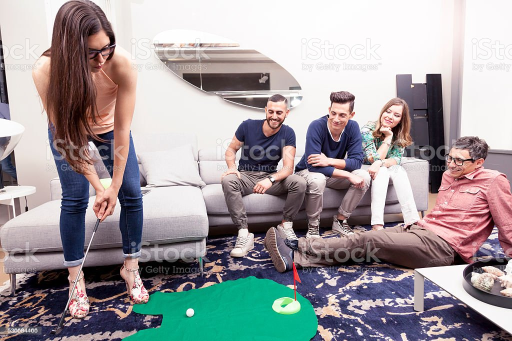 group of young adults have fun playing golf stock photo