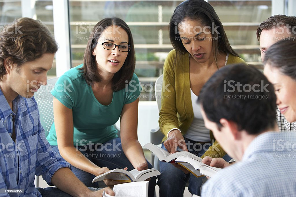 Group of young adults having a bible study stock photo