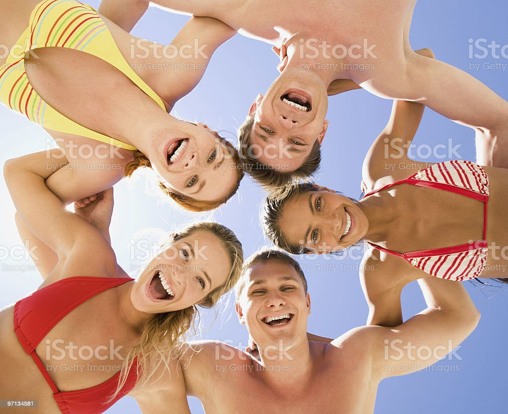 Group of young adults playing at the beach royalty-free stock photo