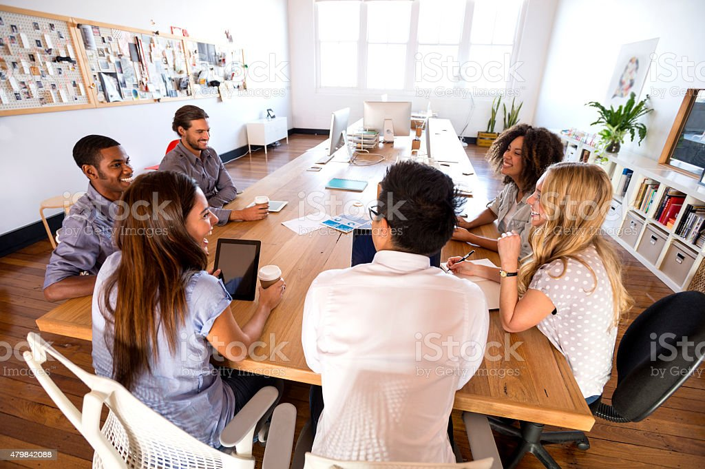 Group of young business people in a meeting. stock photo
