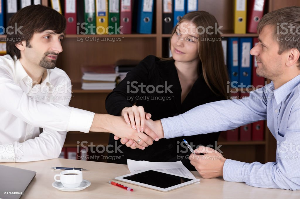 Group of young Business People shaking Hands stock photo