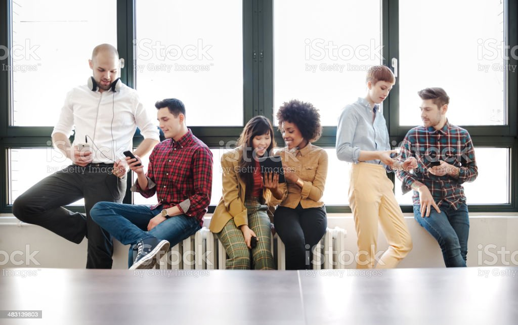 Group Of Young Business People With Smart Phones royalty-free stock photo