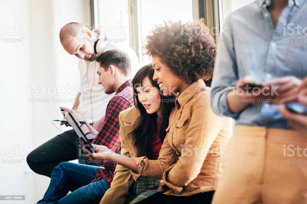 Group Of Young Business People With Smart Phones stock photo