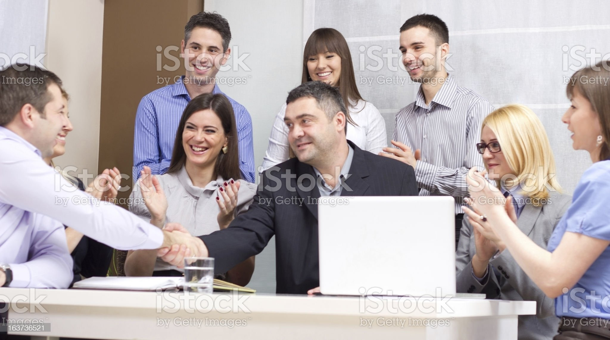 Group of young business people working in the office royalty-free stock photo