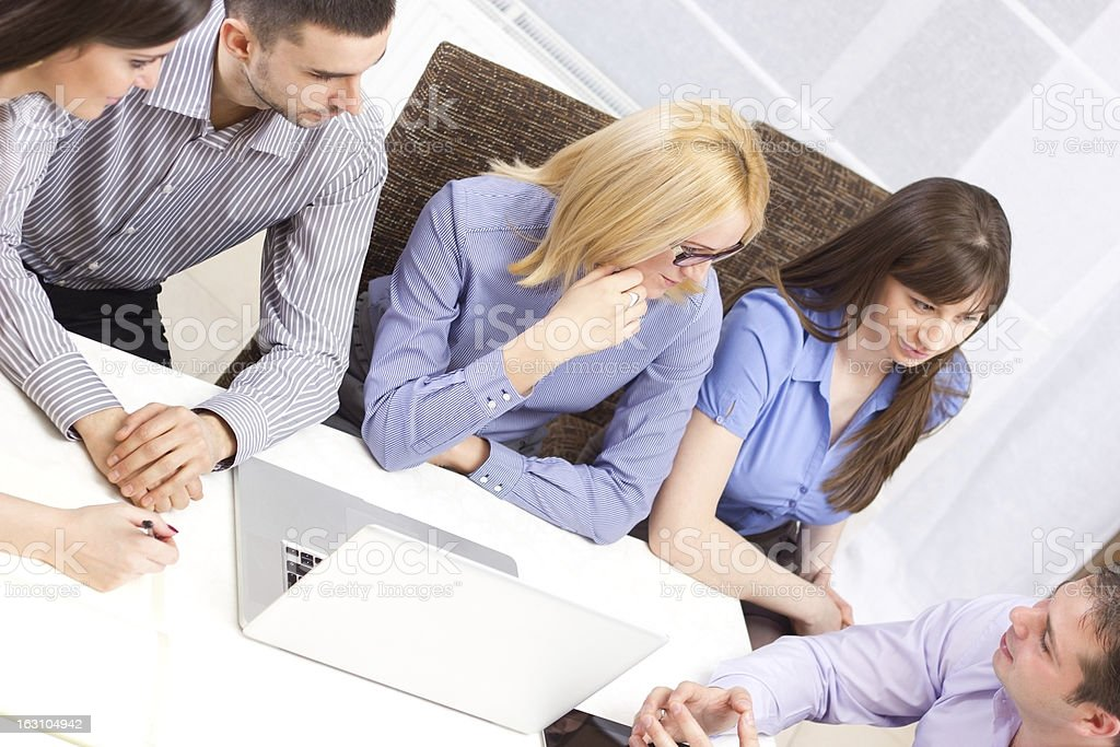Group of young business people working on tablet royalty-free stock photo