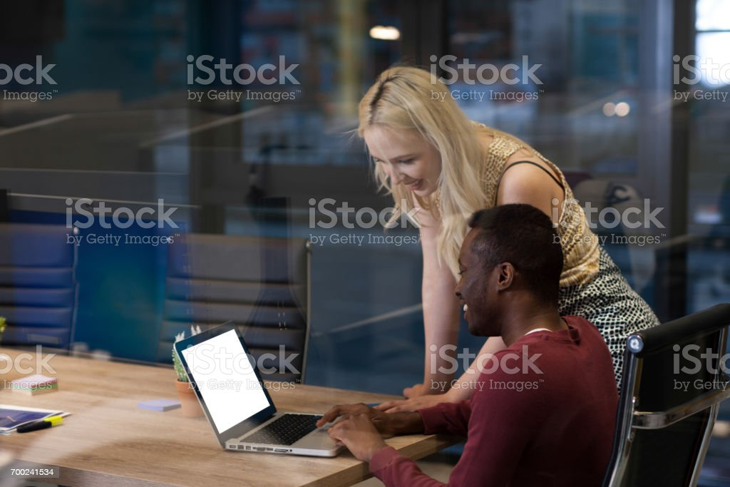 Group of young business people working relaxed stock photo