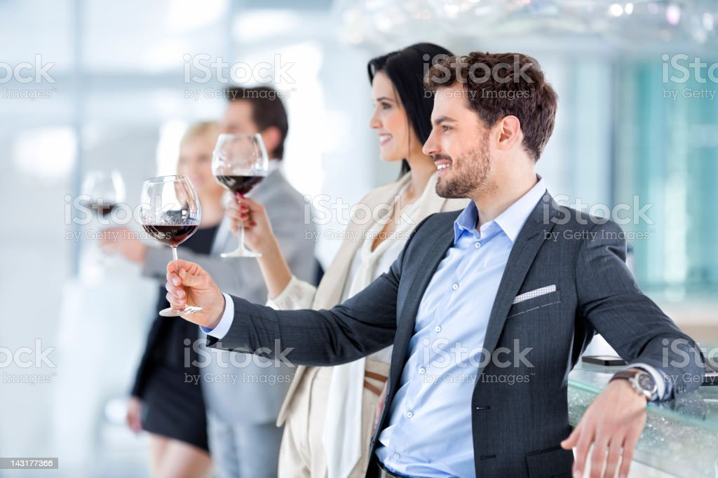Group of young businesspeople,work colleagues toasting in restaurant royalty-free stock photo